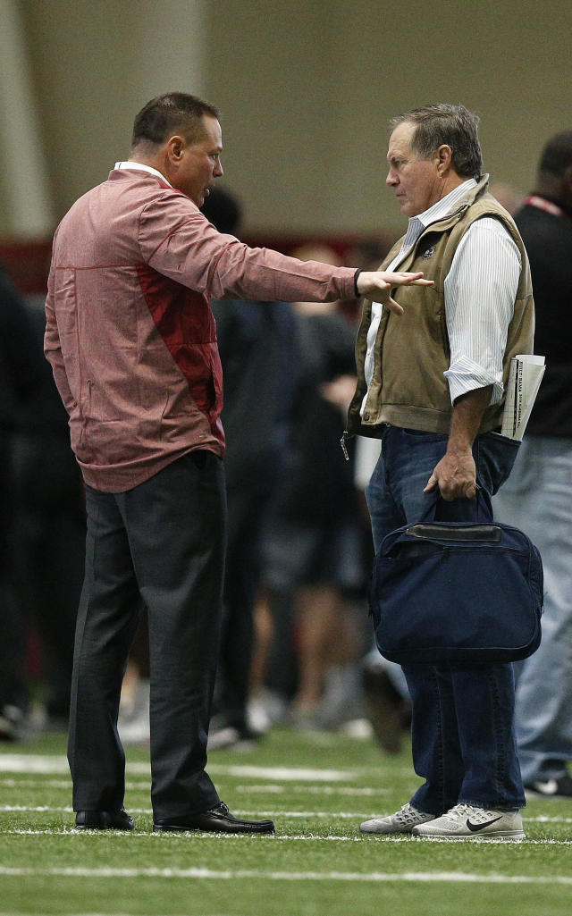 Former Tennessee coach Butch Jones, left, talks with New England Patriots coach Bill Belichick, right, during Alabama's Pro Day, Wednesday, March 7, 2018, in Tuscaloosa, Ala. The event is to showcase players for the upcoming NFL football draft. (AP Photo/Brynn Anderson)