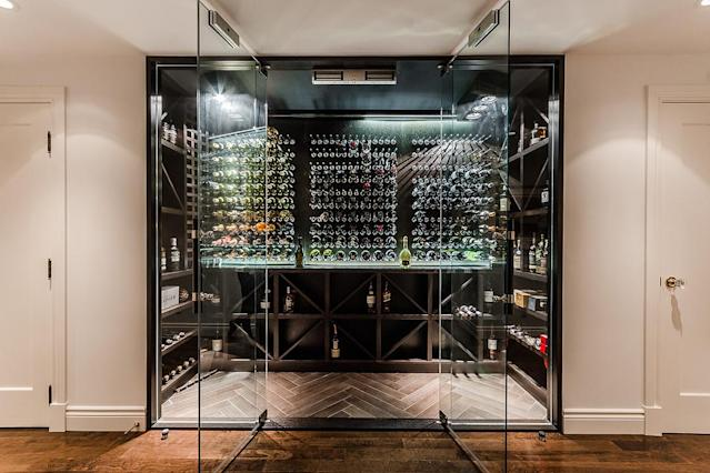 <p>The basement has a home theatre, workshop, maid's quarters, and this contemporary wine cellar. (Listing via <span>Sotheby's</span>) </p>