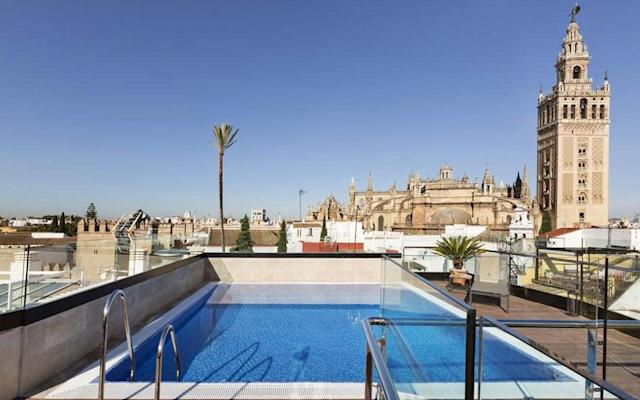An expert guide to the top boutique hotels in Seville, including the best places to stay for quirky and eclectic design, cool rooftop pools and bars, sumptuous spas and more, in locations including the Alameda distric and Santa Cruz. Hotel Palacio De VillapanesSeville, Andalucia, Spain 8Telegraph expert rating Some hotels ooze class, and this grand, former 18th-century palacio feels every inch the Andalusian palace that it is. It's not just period glamour – there are Moorish arches and ornate tilework, mottled marble pillars and parquet floors, but also highly contemporary styling throughout. The basement breakfast room with its whitewashed, arched ceiling feels like something out of a space-age Sixties James Bond film, while the spa has a twinkling, starry-night-effect ceiling. Read expert review From £155per night Check availability Rates provided by Booking.com • The best hotels in Seville Alcoba del Rey de SevillaSeville, Andalucia, Spain 8Telegraph expert rating A fabulous choice if you want to stay somewhere stylish and reasonably central without breaking the bank. Each of the 15 individually designed rooms, named after a historical figure or poet and housed in a converted Mudejar palace, conjure up the spirit of al Andaluz – Seville's Moorish history – with Arabian arches and hand-carved Moroccan furniture. Lanterns cast gentle shadows on walls of deep terracotta, while Kilim rugs and floor candles decorate corridors. There's a small roof terrace with sun loungers and a whirlpool tub – a brilliant spot to escape the Seville heat in the height of summer. Read expert review From £63per night Check availability Rates provided by Booking.com • The best hotels in Andalusia Casa del PoetaSeville, Andalucia, Spain 9Telegraph expert rating So discreet it doesn't even have a sign. This restored 17th-century mansion hidden down a tiny alley in Santa Cruz offers service worthy of a five-star establishment, plus nightly live guitar performances, a superbly-stocked bar, and a large roof terrace with cathedral views. The hotel is built in the typical Sevillano style of rooms around an arcaded patio with a fountain. Unusually, this patio is open-air rather than roofed, and bursting with greenery; terracotta pots of frondy ferns and vibrant geraniums, and ivy hanging from the upper floors with tendrils trailing romantically over the balconies. Read expert review From £140per night Check availability Rates provided by Booking.com • The 50 greatest hotels in Spain Corral Del ReySeville, Andalucia, Spain 8Telegraph expert rating A 17th-century palacio in the heart of Seville's old town has been reinvented as a deluxe boutique hotel by English brothers Anthony and Patrick Reid. It's a classy affair with fine art on the walls amid marble and Romanesque pillars. Farrow & Ball-style muted sandstones and greys are not shades you'd normally associate with the golden sunlight and warm-blooded drama of Andalusia, but then most Seville hotels are not run by Englishmen. The hotel was made over by interior designer Kuky Mora-Figueroa, with a mix of dark-wood antique desks, carved Moroccan mirrors, Scandinavian oak-panelled floors and beamed ceilings. Read expert review From £156per night Check availability Rates provided by Booking.com • The best places to visit in Spain and where to stay Boutique Hotel HolosSeville, Andalucia, Spain 7Telegraph expert rating Design fans will love this sleekly architectured boutique hotel in the suburbs of Seville. You won't get a conveniently central location but you will get design credentials in spades and an elegant, lilac-filled gravel garden to escape the heat. Everything from the brushed steel walls and blonde-wood sliding panels in reception to the lime green and orange loo rolls in the bathrooms feel like something out of a magazine. There's no pool but there is a small roof terrace and a pretty, gravelled garden with Daniel Libeskind-style jagged steel fencing and steel tables and chairs amidst overhanging lemon trees and lilac bushes. Read expert review From £58per night Check availability Rates provided by Booking.com • The most romantic hotels in Seville Casa de ColónSeville, Andalucia, Spain 8Telegraph expert rating A cleverly-balanced blend of exposed brick walls with zingy colours, ethnic prints and repurposed furniture make this family-owned 18th-century conversion, halfway between the cathedral and Plaza San Francisco, a stylish city-centre steal. Unusual period features – striking cobalt-blue glass, neo-mudejar scalloped windows, and cast-iron pillars in the patio, with the maker's name stamped on them – lend this two-star hotel plenty of character. Read expert review From £52per night Check availability Rates provided by Booking.com • Where to stay in Seville - hotels by district Mercer SevillaSeville, Andalucia, Spain 9Telegraph expert rating This temple to contemporary design in a restored palace offers an impressive, nicely-located historic space with sharply-styled interiors and cutting-edge comforts, plus a rooftop terrace with pool and bar. The hotel's style marries a traditional Andalucia casa palacio from the late 19th century – noble façade with wrought-iron balconies, deliciously glamorous curved marble staircase, magnificent light-filled patio with glass panelling, grand arches and fountain – with bang-up-to-date European furnishings. Read expert review From £290per night Check availability Rates provided by Booking.com • The best hotels in Malaga Hotel Sacristía de Santa AnaSeville, Andalucia, Spain 8Telegraph expert rating A boutique hotel in a converted 18th-century mansion, delightfully relaxed considering Seville's hottest restaurant and bar scene is on its doorstep. Quirky furniture, period details and great value make this family-owned spot the top choice in the Alameda district. The central Andalusian patio sets the mood – hand-laid oxblood ceramic floor with bijou Arabic-style marble fountain in the centre, and replica Roman amphorae on the wall, as well as original columns found in the basement. Communal areas on all floors are genuinely boutique, featuring hand-painted side tables and chests of drawers in zingy shades, made to order in France. Read expert review From £54per night Check availability Rates provided by Booking.com • The best hotels in Granada Hotel Casa 1800Seville, Andalucia, Spain 8Telegraph expert rating The idea of a cool oasis amid the heat and hubbub of the city centre may be a cliché, but this elegantly converted mayor's mansion is exactly that. As you enter the vast wooden doors, the gentle sound of a trickling water fountain belies the fact that you're just yards away from La Giralda. You'll find a mix of Louis XIV-style gilt chandeliers, high wooden-beamed ceilings, parquet floors and contemporary, neutral-toned damasks and velvets. It's quietly grand and sophisticated without being loud or ostentatious. Details such as fresh tiger lilies and soothing Spanish guitar music make this feel every inch the classy boutique hotel. Read expert review From £117per night Check availability Rates provided by Booking.com • The best hotels in Spain Casa RomanaSeville, Andalucia, Spain 8Telegraph expert rating This classically elegant hotel dotted with clever repro Roman sculptures is located in a handy position between the hip Alameda district with its boho bar-gallery-shops, and the main central shopping area. Twenty-six rooms are arranged around two patios - the hotel is made up of adjoining 18th-century casa-palacios (mansions). The smaller, rear patio is open-air and plant-filled, with antique tiles and a fountain, while the larger main one is covered but still feels light, thanks to the grand dimensions of the front three-storey mansion with its marble floors. Read expert review From £47per night Check availability Rates provided by Booking.com