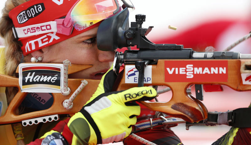 Gabriela Soukalova of Czech Republic shoots during the women's Pursuit 10 km competition at the Biathlon World Cup in Ruhpolding, Germany, Sunday, Jan, 12, 2014. (AP Photo/Matthias Schrader)