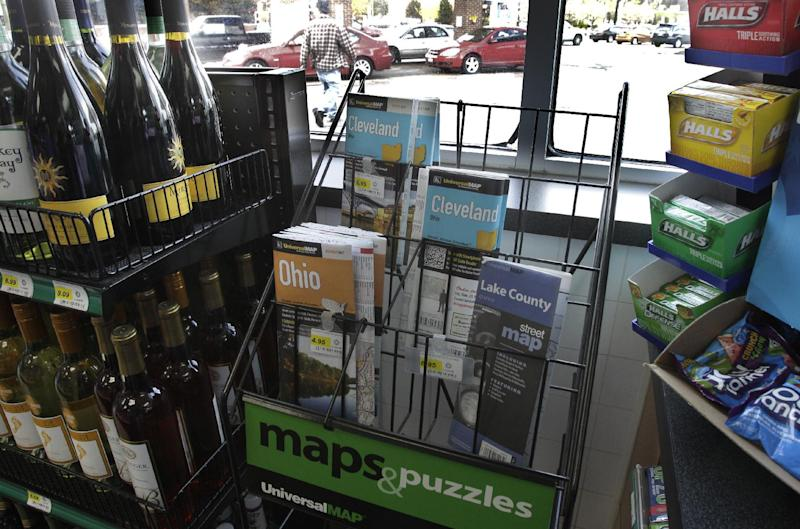 In this Monday, April 9, 2012 photo a scant rack of road maps is seen at a gas station/mini mart in Solon, Ohio on. Colorful maps bearing the logos of the oil companies that printed them _ names like Texaco, Gulf, Esso _ once brimmed from displays at filling stations, free for the taking. (AP Photo/Amy Sancetta)
