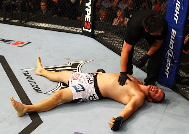 ATLANTA, GA - APRIL 21: Chad Griggs lays on the mat after tapping out during his heavyweight bout against Travis Browne for UFC 145 at Philips Arena on April 21, 2012 in Atlanta, Georgia.