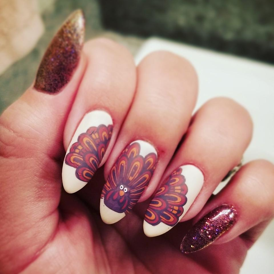 Nail artist Alana Folger shared an incredible manicure featuring a detailed turkey illustration that's so beautiful, it deserves to stretch across three nails. The off-white base color really lets the feather colors pop, and the pinky and thumbnail bookend the art with sparkling brown polish.