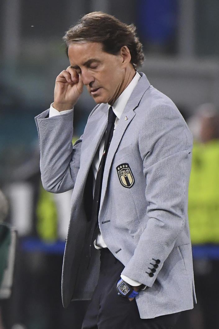 Italy's manager Roberto Mancini gestures during the Euro 2020 soccer championship group A match between Italy and Turkey at the Olympic stadium in Rome, Friday, June 11, 2021. (Alberto Lingria/Pool Photo via AP)