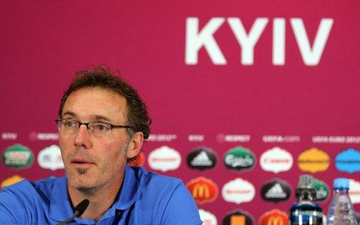 French coach Laurent Blanc takes part in a press conference at the Olympic stadium in Kiev