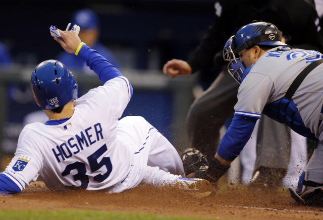 Kansas City Royals' Eric Hosmer (35) is tagged out by Toronto Blue Jays catcher Dioner Navarro, right, during the third inning of a baseball game in Kansas City, Mo., Thursday, May 1, 2014. Hosmer tried to score on a single by teammate Billy Butler. (AP Photo/Orlin Wagner)