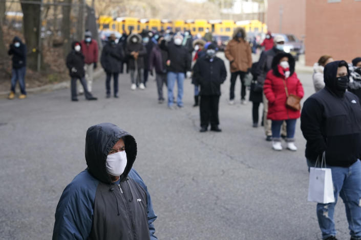 People wait in line for the COVID-19 vaccine in Paterson, N.J., Thursday, Jan. 21, 2021. Some hospitals around the U.S. are facing complaints about favoritism and line-jumping after their board members and donors received COVID-19 vaccinations or offers for the prized inoculations. (AP Photo/Seth Wenig)