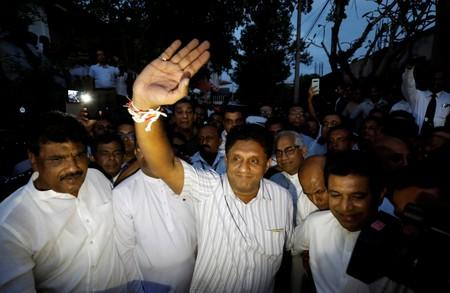 Sri Lanka's housing minister and deputy leader of the ruling United National Party Premadasa waves at his supporters at the party office after he was nominated as a presidential candidate in Colombo