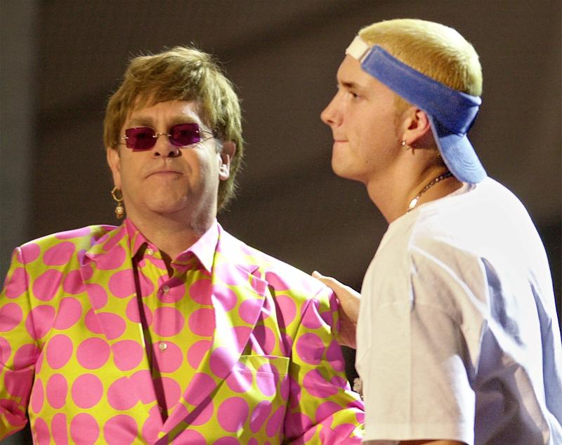 Elton John, left, and Eminem share the stage following their duet at the 43rd annual Grammy Awards Wednesday, Feb. 21, 2001, at the Staples Center in Los Angeles. (AP Photo/Kevork Djansezian)
