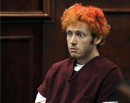 "James Holmes, who is accused of killing a dozen people at a Colorado screening of ""The Dark Knight Rises,"" sent a chilling warning of his plans in a parcel which sat unopened in a university mailroom"