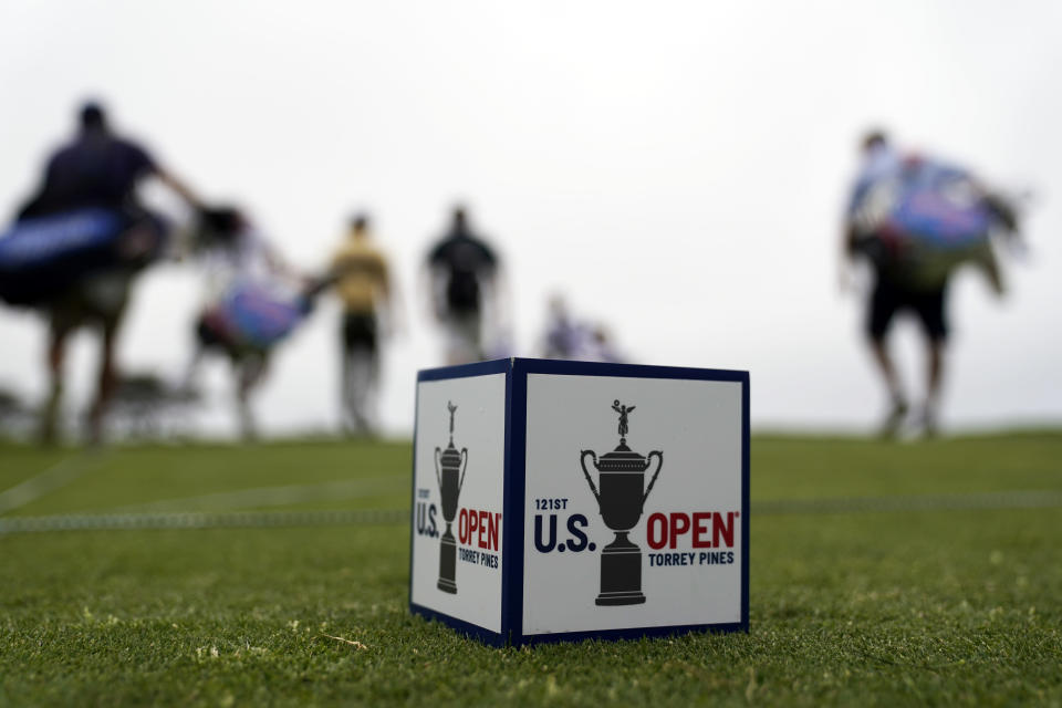 Golfers and caddies walk along the 16th hole during a practice round of the U.S. Open Golf Championship, Monday, June 14, 2021, at Torrey Pines Golf Course in San Diego. (AP Photo/Gregory Bull)