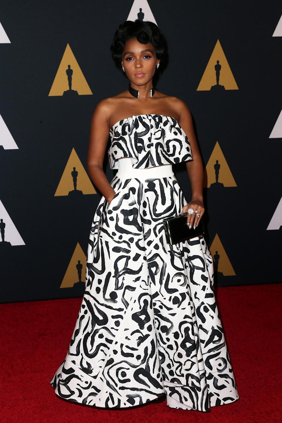 <p>The singer ditched her usual tux, instead opting for a hand-painted black-and-white gown. <i>[Photo: Getty]</i> </p>