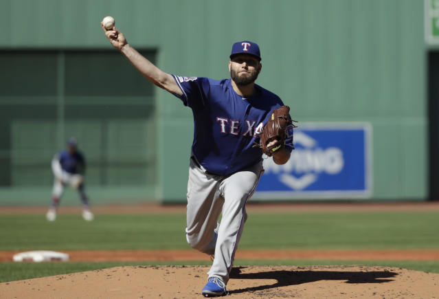 Texas Rangers starting pitcher Lance Lynn delivers to the Boston Red Sox in the first inning of a baseball game at Fenway Park, Wednesday, June 12, 2019, in Boston. (AP Photo/Elise Amendola)