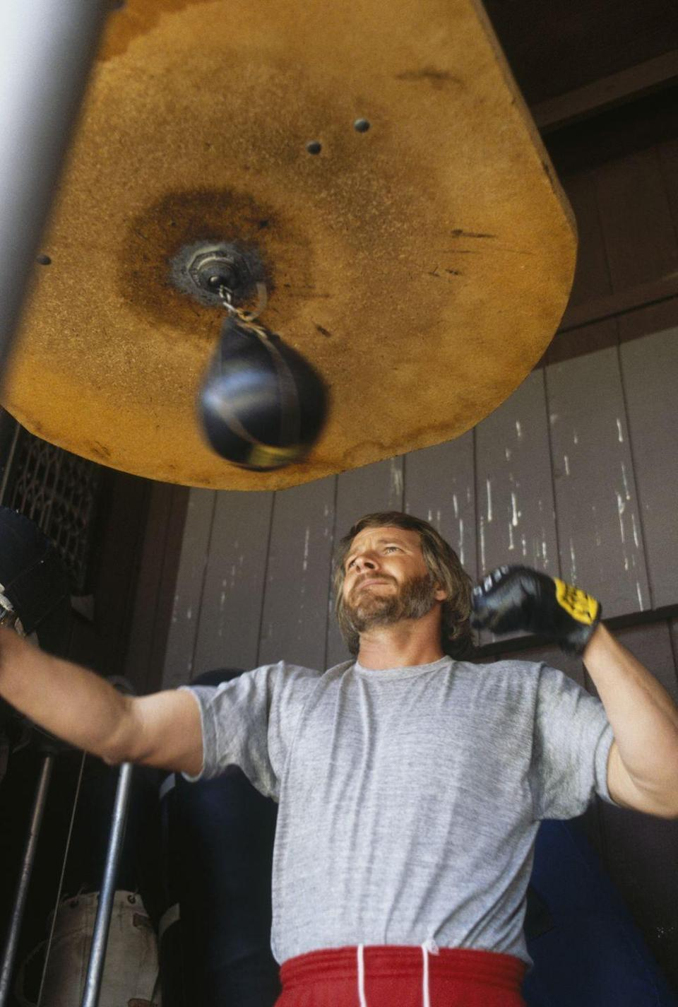 <p>Recreational boxing became a thing in the '70s, and as such, no gym was complete without its own speed bag. Here, Raiders quarterback Ken Stabler uses it to train. </p>