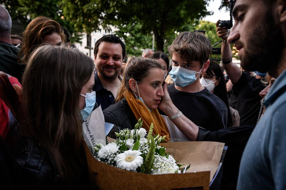 Valerie Bacot (C) leaves Chalon-sur-Saone Courthouse, flanked by relatives and lawyers applauded and congratulated by passers-by, in Chalon-sur-Saone, central-eastern France, on June 25, 2021 at the end of her trial on charges of murdering her stepfather turned husband, who she claimed abused her since she was 12. - Valerie Bacot was sentenced on June 25, 2021 to a symbolic four-year prison term, three of which were suspended, for the murder of her pimp husband, allowing her to walk out of court free, having already spent a year in custody. (Photo by JEFF PACHOUD / AFP) (Photo by JEFF PACHOUD/AFP via Getty Images)
