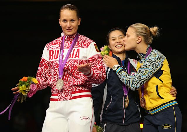 LONDON, ENGLAND - AUGUST 01: (L-R) Silver medalist Sofya Velikaya of Russia, gold medalist Jiyeon Kim of Korea and bronze medalist Olga Kharlan of Ukraine pose on the podium during the medail ceremony in the Women's Sabre Individual Fencing Gold on Day 5 of the London 2012 Olympic Games at ExCeL on August 1, 2012 in London, England. (Photo by Hannah Johnston/Getty Images)