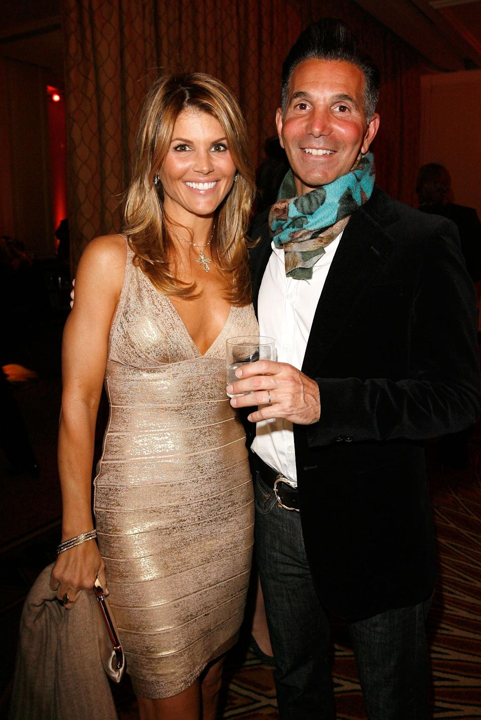 BEVERLY HILLS, CA - FEBRUARY 20:  Actress Lori Loughlin (L) and husband Mossimo Giannulli attend the Saks Fifth Avenue's Unforgettable Evening cocktail reception benefiting Entertainment Industry Foundation's (EIF) Women's Cancer Research Fund held at the Beverly Wishire Hotel on February 20, 2008 in Beverly Hills, California.  (Photo by Donato Sardella/WireImage)