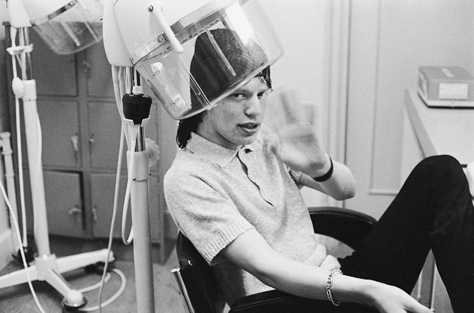<p>Mick Jagger having his hair styled at the BBC studios before an appearance on television, 1963.</p>