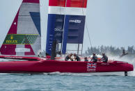 In this photo provided by SailGP, the Britain SailGP Team presented by INEOS, helmed by Sir Ben Ainslie, race toward the finish line in first place in the final race on race Day 2 of the Bermuda SailGP event in Hamilton, Bermuda, Sunday, April 25, 2021. (Bob Martin/SailGP via AP)