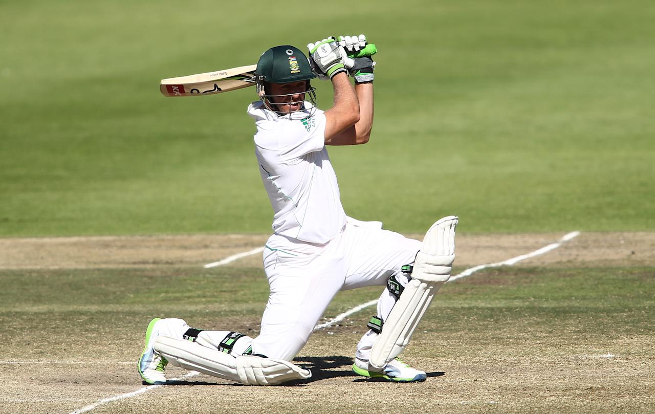 CAPE TOWN, SOUTH AFRICA - FEBRUARY 17:  AB de Villiers of South Africa drives a delivery to the boundary during day 4 of the 2nd Sunfoil Test match between South Africa and Pakistan at Sahara Park Newlands on February 17, 2013 in Cape Town, South Africa. (Photo by Shaun Roy/Gallo Images/Getty Images)