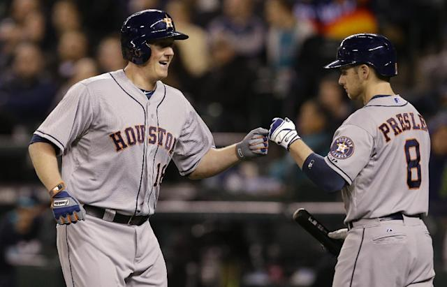 Houston Astros' Marc Krauss, left, greets Alex Presley, right, after Krauss hit a solo home run against the Seattle Mariners in the eighth inning of a baseball game, Monday, April 21, 2014, in Seattle. (AP Photo/Ted S. Warren)