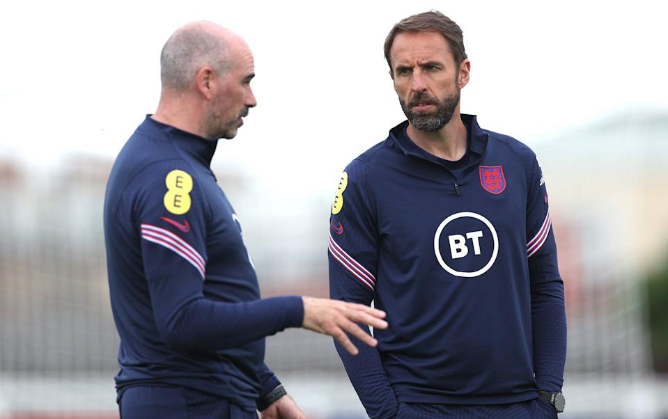 Mitchell and Southgate chatting during an England training session at St George's Park - GETTY IMAGES
