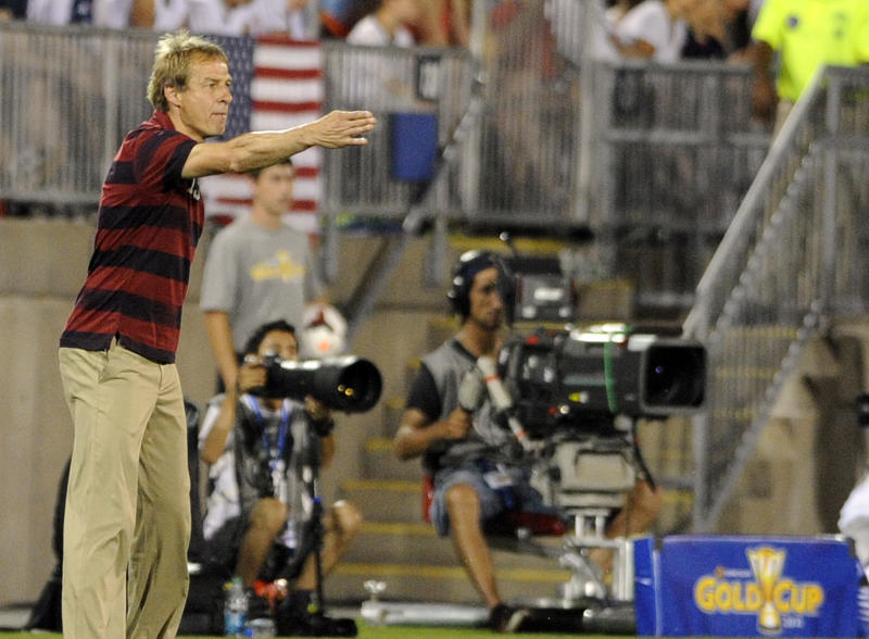U.S. coach Jurgen Klinsmann watches his team during the second half of a CONCACAF Gold Cup soccer match against Costa Rica on Tuesday, July 16, 2013, in East Hartford, Conn. The United States won 1-0. (AP Photo/Fred Beckham)