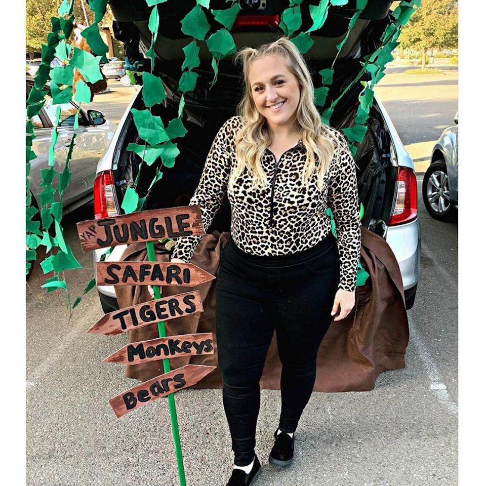 """<p>In the spirit of Carol Baskins, this safari-themed trunk-or-treat is a super easy one to execute. You can DIY the signpost or add in a <a href=""""https://www.bestproducts.com/lifestyle/g33474762/joe-exotic-costume-ideas/"""" rel=""""nofollow noopener"""" target=""""_blank"""" data-ylk=""""slk:Tiger King-esque prop"""" class=""""link rapid-noclick-resp""""><em>Tiger King</em>-esque prop</a> if that's the direction you're headed. </p><p><a class=""""link rapid-noclick-resp"""" href=""""https://www.amazon.com/DearHouse-Strands-Artificial-Hanging-Garland/dp/B07QVLGYG6?tag=syn-yahoo-20&ascsubtag=%5Bartid%7C2089.g.33658548%5Bsrc%7Cyahoo-us"""" rel=""""nofollow noopener"""" target=""""_blank"""" data-ylk=""""slk:Shop Hanging Vines"""">Shop Hanging Vines</a></p>"""