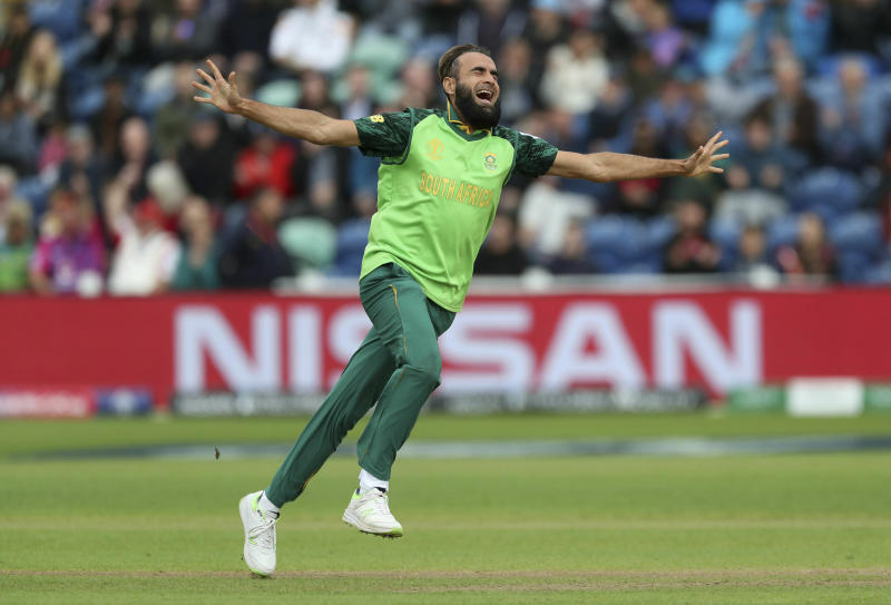 South Africa's Imran Tahir celebrates taking the wicket of Afghanistan's Noor Ali Zadran during the ICC Cricket World Cup group stage match at The Cardiff Wales Stadium in Cardiff, Wales, Saturday June 15, 2019.  (David Davies/PA via AP)