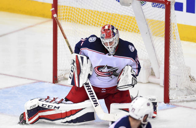 Columbus Blue Jackets goaltender Sergei Bobrovsky (72), of Russia, stops the puck during overtime in Game 2 of an NHL first-round hockey playoff series, Sunday, April 15, 2018, in Washington. The Blue Jackets won 5-4 in overtime. (AP Photo/Nick Wass)