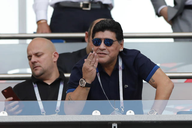 Argentinian soccer legend Diego Armando Maradona gestures during the round of 16 match between France and Argentina, at the 2018 soccer World Cup at the Kazan Arena in Kazan, Russia, Thursday, June 28, 2018. (AP Photo/Ricardo Mazalan)
