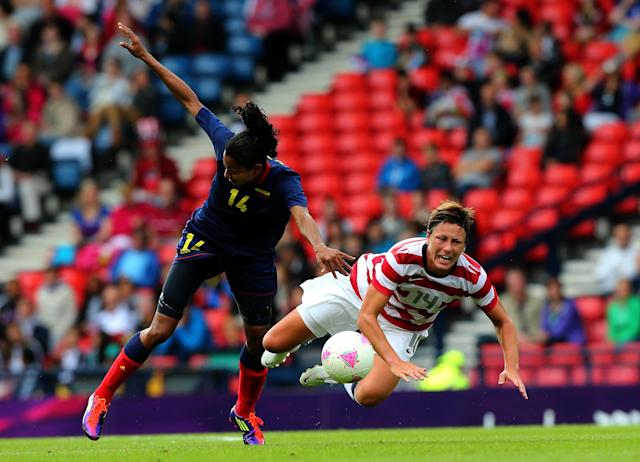 GLASGOW, SCOTLAND - JULY 28: Abby Wambach (R) of USA clashes with Kelis Peduzine of Columbia during the Women's Football first round Group G match between United States and Colombia on Day 1 of the London 2012 Olympic Games at Hampden Park on July 28, 2012 in Glasgow, Scotland. (Photo by Stanley Chou/Getty Images)