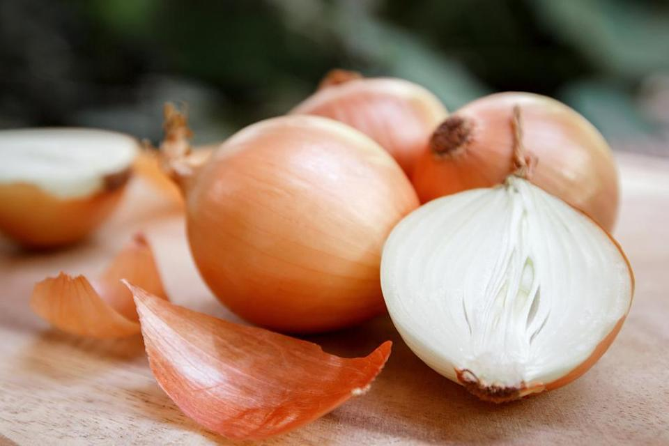 """<p><a href=""""https://www.thedailymeal.com/cutting-onion-with-water?referrer=yahoo&category=beauty_food&include_utm=1&utm_medium=referral&utm_source=yahoo&utm_campaign=feed"""" rel=""""nofollow noopener"""" target=""""_blank"""" data-ylk=""""slk:Chopping onions"""" class=""""link rapid-noclick-resp"""">Chopping onions</a> may be an unpleasant task, but the last thing you want is a rotten onion spreading a bad aroma in your kitchen. If you're not storing your onions in a mesh bag away from the fridge, <a href=""""https://www.thedailymeal.com/cook/storing-groceries-wrong?referrer=yahoo&category=beauty_food&include_utm=1&utm_medium=referral&utm_source=yahoo&utm_campaign=feed"""" rel=""""nofollow noopener"""" target=""""_blank"""" data-ylk=""""slk:you're doing it wrong"""" class=""""link rapid-noclick-resp"""">you're doing it wrong</a>. Onions need to be kept in well-ventilated places away from moisture. If you see moisture and soft spots, it can be a sign that your stash of onions is going bad.</p>"""