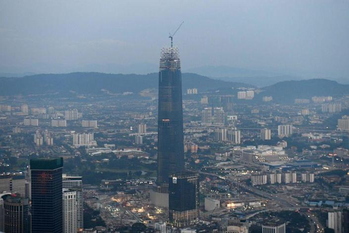 <p><strong>Location:</strong> Kuala Lumpur, Malaysia </p><p><strong>Height:</strong> 1,462 feet</p><p><strong>Completion date:</strong> 2019</p><p>Using a 12-story illuminated crown to accentuate the height of The Exchange 106 in the Tun Razak Exchange financial district development in Kuala Lumpur, the new skyscraper gives visitors a shiny new example of height in Malaysia. The Peter Chan Architect design is structurally completed with the opening, including a mix of uses, of the 106-floor building planned for 2019. </p>