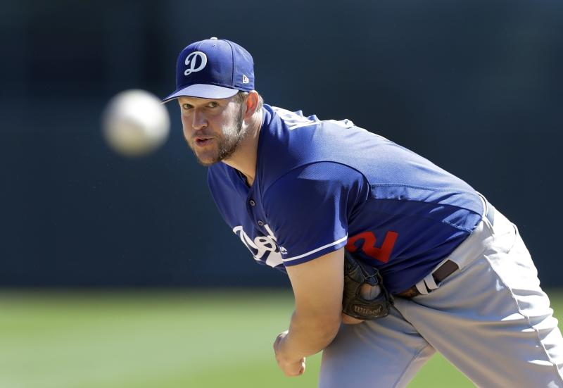 Clayton Kershaw and the Dodgers are looking to rebound after falling one game short of winning the World Series. (AP)