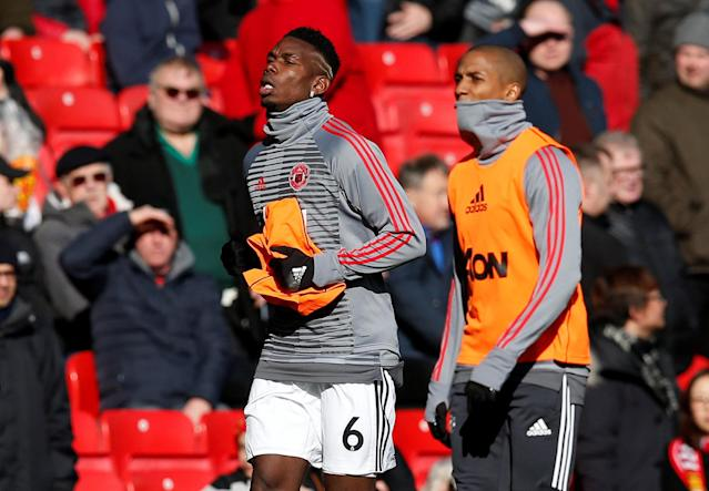"Soccer Football - Premier League - Manchester United vs Chelsea - Old Trafford, Manchester, Britain - February 25, 2018 Manchester United's Paul Pogba and Ashley Young warm up before the match REUTERS/Andrew Yates EDITORIAL USE ONLY. No use with unauthorized audio, video, data, fixture lists, club/league logos or ""live"" services. Online in-match use limited to 75 images, no video emulation. No use in betting, games or single club/league/player publications. Please contact your account representative for further details."