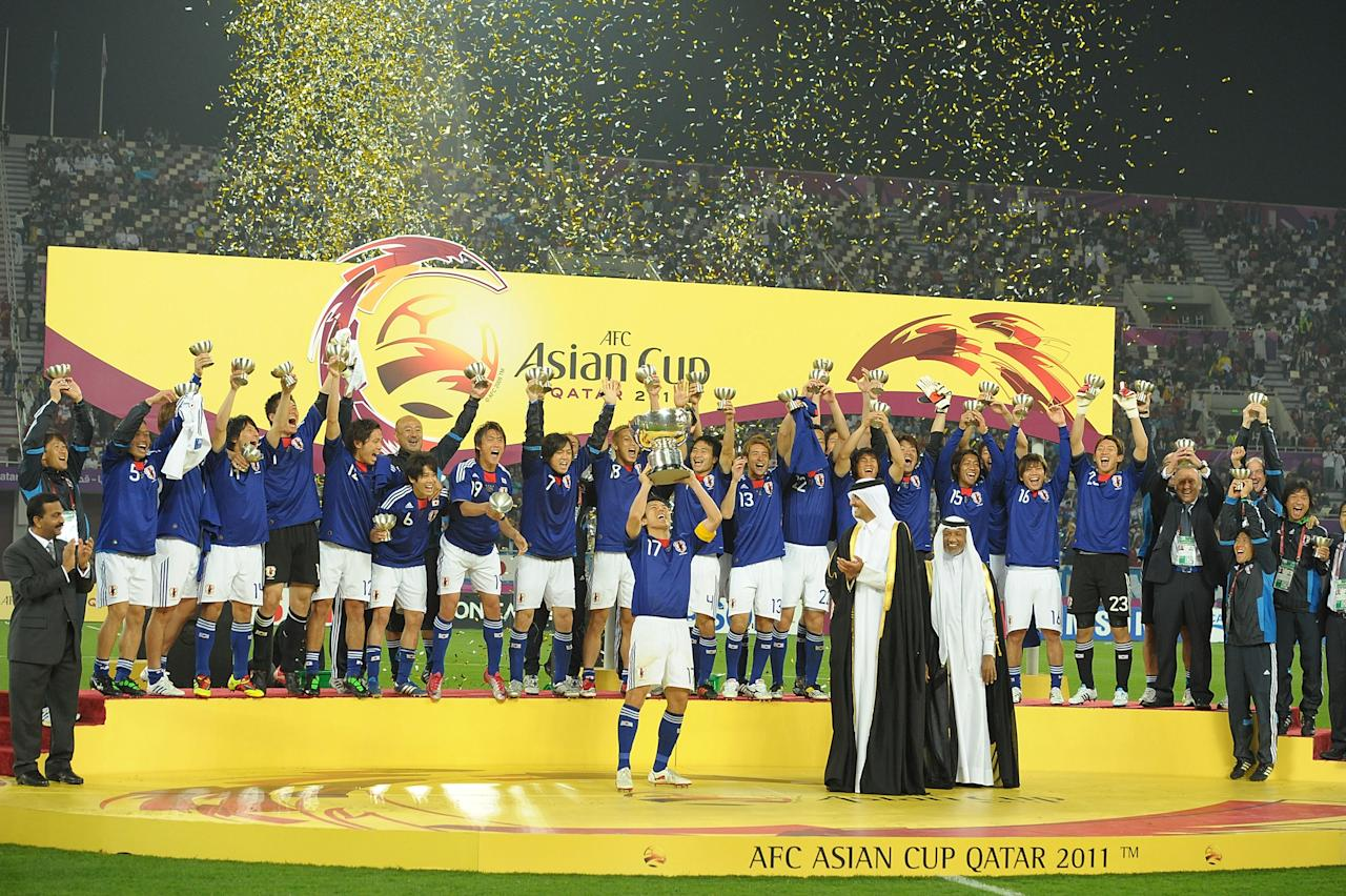 DOHA, QATAR - JANUARY 29:  The Japanese team celebrate winning the AFC Asian Cup Final match between the Australian Socceroos and Japan at Khalifa International Stadium on January 29, 2011 in Doha, Qatar.  (Photo by Koki Nagahama/Getty Images)