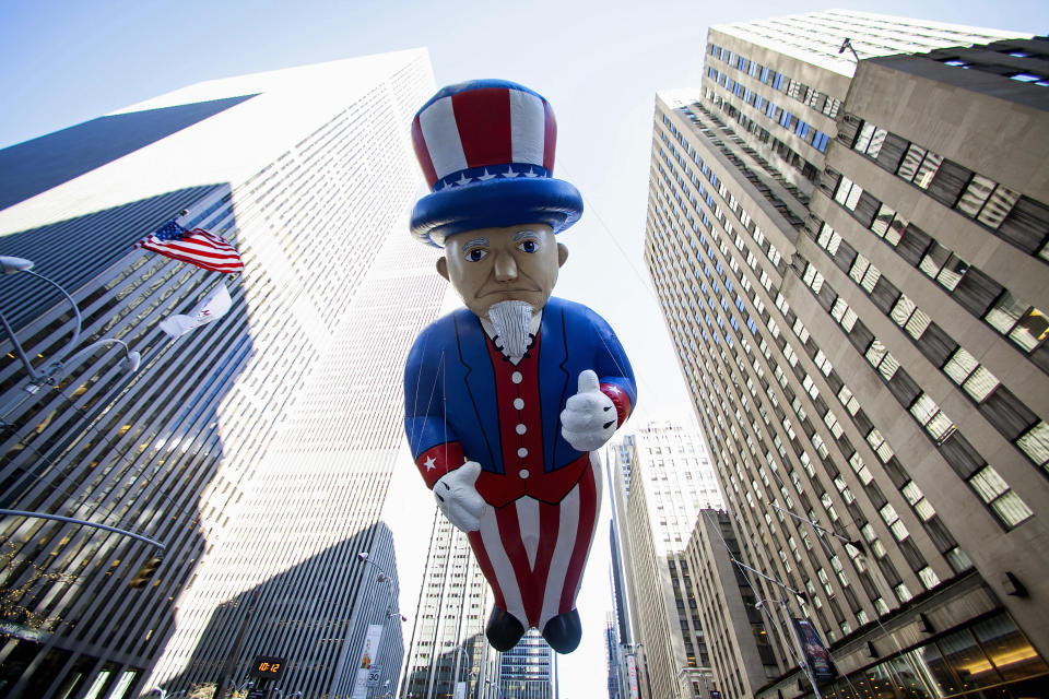 An Uncle Sam balloon floats down Sixth Avenue during the 87th Macy's Thanksgiving Day Parade in New York November 28, 2013. REUTERS/Eric Thayer (UNITED STATES - Tags: SOCIETY ENTERTAINMENT TPX IMAGES OF THE DAY)