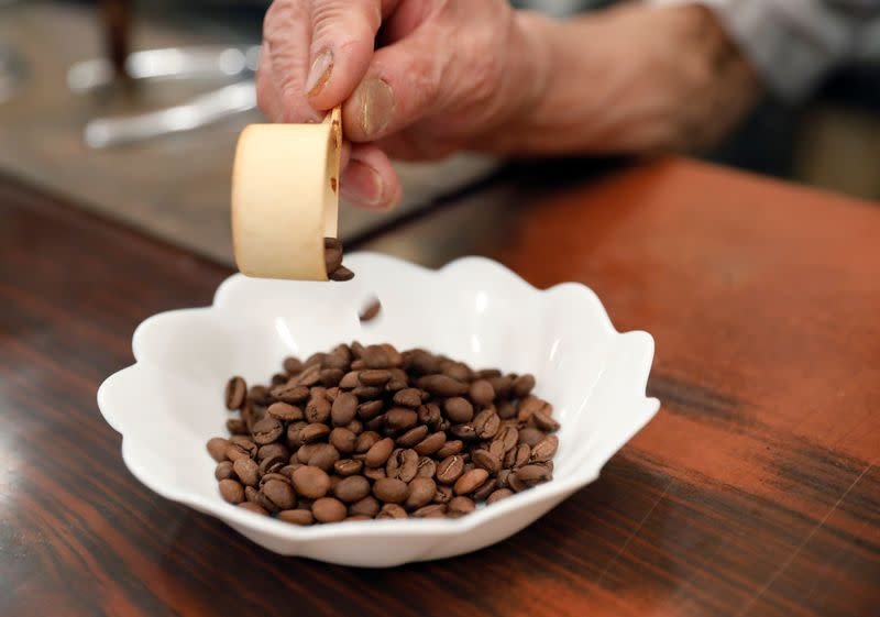 Shizuo Mori, the owner of Heckeln coffee shop prepares to grind coffee beans at his shop in Tokyo