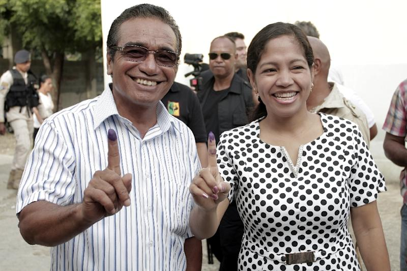 Former East Timor guerrilla fighter Francisco Guterres (L), with his wife after voting Monday, has won the presidential election in just one round, according to an early count