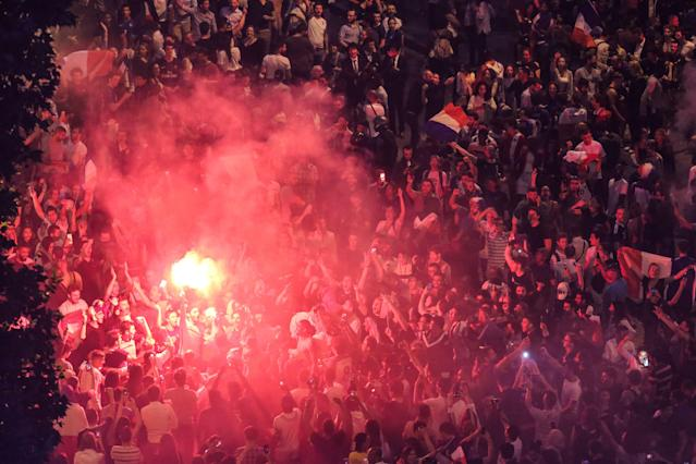 <p>People celebrate France's victory on the Champs Elysees in Paris on July 10, 2018, after the final whistle of the Russia 2018 World Cup semi-final football match between France and Belgium. (Photo by Zakaria ABDELKAFI / AFP) </p>