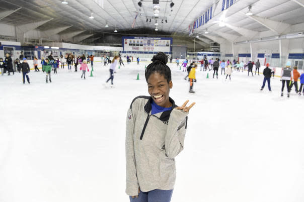 Maame Biney, 17-year old short track speed skater from Reston, poses on the SkateQuest ice rink where she first skated as a 5-year-old. (Getty Images)
