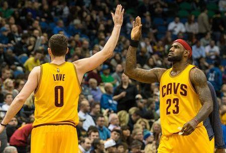 Jan 31, 2015; Minneapolis, MN, USA; Cleveland Cavaliers forward Kevin Love (0) celebrates with forward LeBron James (23) during the fourth quarter against the Minnesota Timberwolves at Target Center. The Cavaliers defeated the Timberwolves 106-90. Mandatory Credit: Brace Hemmelgarn-USA TODAY Sports