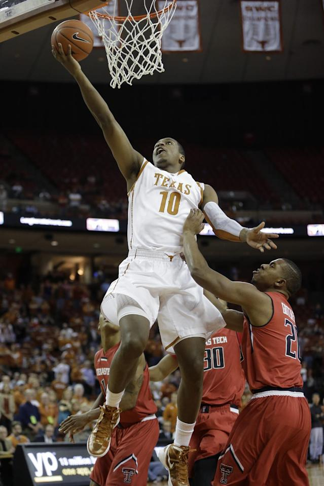 Texas' Jonathan Holmes (10) scores over Texas Tech's Toddrick Gotcher, right, during the first half of an NCAA college basketball game on Saturday, Jan. 11, 2014, in Austin, Texas. (AP Photo/Eric Gay)