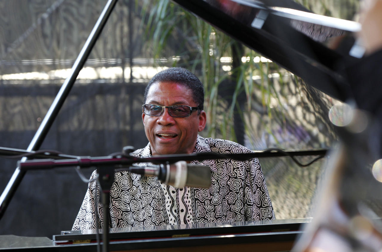 Herbie Hancock, performs at a sunrise concert marking International Jazz Day in New Orleans, Monday, April 30, 2012. The performance, at Congo Square near the French Quarter, is one of two in the United States that day; the other is in the evening in New York. Thousands of people across the globe are expected to participate in International Jazz Day, including events in Belgium, France, Brazil, Algeria and Russia. (AP Photo/Gerald Herbert)