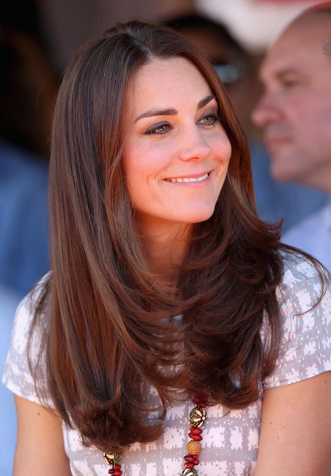 <p>The Duchess kept things simple on a trip to Australia in 2014, enhancing her long layers with a simple blowout.</p>