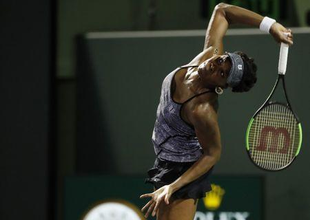 Mar 29, 2017; Miami, FL, USA; Venus Williams of the United States serves against Angelique Kerber of Germany (not pictured) on day nine of the 2017 Miami Open at Crandon Park Tennis Center. Williams won 7-5, 6-3. Mandatory Credit: Geoff Burke-USA TODAY Sports