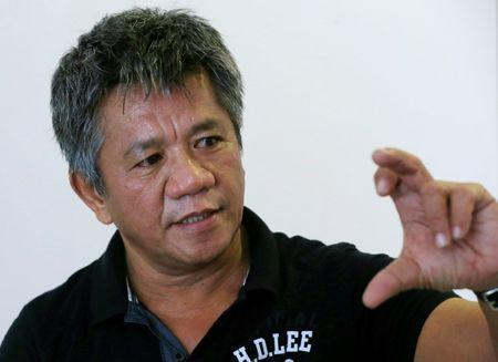 Edgar Matobato, a self-confessed former hitman, gestures during a Reuters interview inside a safehouse in metro Manila