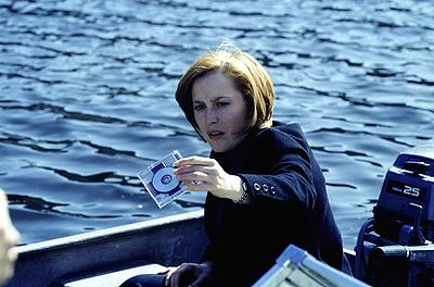 Agent Dana Scully (Gillian Anderson) holds a disk she believes contains the cure for cancer on Fox's The X-Files X-Files