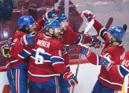 Montreal Canadiens' Josh Anderson (17) celebrates with teammates after scoring against the Vegas Golden Knights during the third period of Game 3 of an NHL hockey semifinal series, Friday, June 18, 2021, in Montreal. (Paul Chiasson/The Canadian Press via AP)